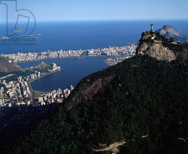 Aerial view of the city of Rio de Janeiro with the statue of the Christ on the Corcovado in the foreground, Brazil - Aerial view of the city of Rio de janeiro with the statue of the Christ on the Corcovado in the foreground, Brazil, 1983 - Photography