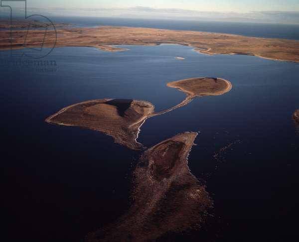 Aerial view of the Monumento Natural Laguna de los Cisnes, Detroit de Magellan in the background, Tierra del Fuego, Chile, 1983 - Aerial view on the Laguna de los cisnes, straight of Magellan in the background, Tierra del Fuego, Chile - 1983 - Photography