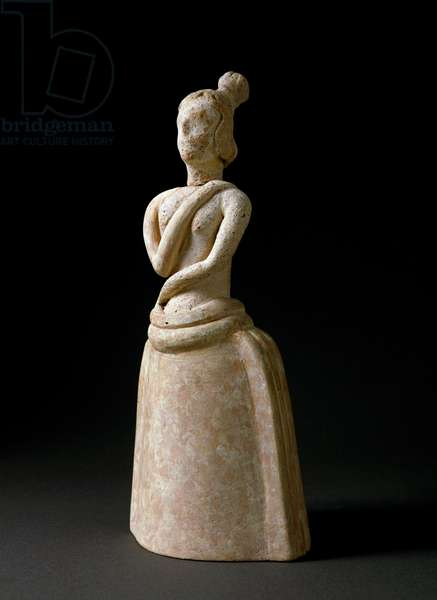 Minoan art: terracotta figurine of woman in an attitude of worship. From the sanctuary of Piskokephalo in Crete. 1700-1450 BC. Dim. 24,6 cm Heraklion, archeological museum