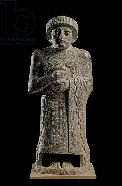 "Sumerian Art: Detail of the Statue of Gudea, Prince of Lagash known as """" with the gushing vase"""" and dedicated to the goddess Geshtinanna"