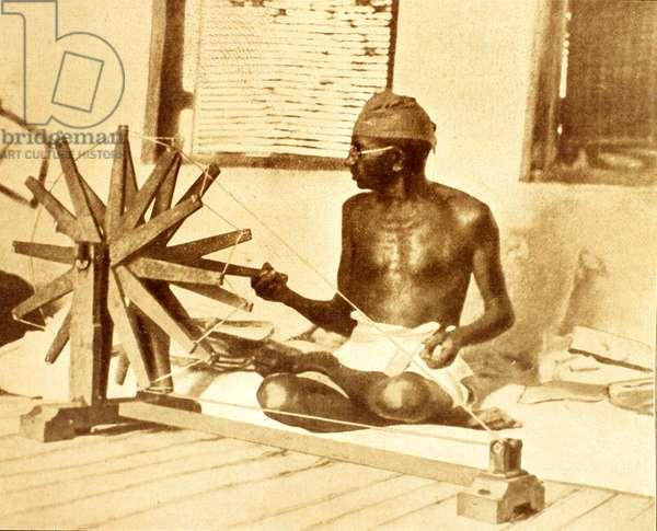 Portrait of Mahatma Gandhi (Mohandas Karamchand Gandhi, 1869-1948) weaving