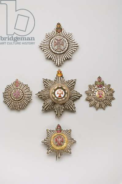 Portugal - Order of Christ - High: plate of grand cross, 1800-1850, Gold and silver and emerald and garnet and crystal of rhinestones, H: 8.7 cm; w: 7,7 cm; weight: 76 g - Bottom: plate of grand cross, 1800-1850, Gold and silver and emerald and ruby, D: 6,4 cm; weight: 52 g - Left: plaque of grand cross for lady, 1850-1900, Gold and silver emerald and ruby, H: 6 , 1 cm; w: 5.8 cm; weight: 36 g - Right: grand cross plate for lady, 1800-1850, Gold and silver and diamonds and emerald and rubies and sapphire and amethyst, H: 6.5 cm; w: 6 cm; weight: 46 g - Center: grand cross plate, 1850-1900, Gold and silver and diamonds and emals, H: 9.7 cm; w: 8.7 cm; weight: 102 g - Private collection