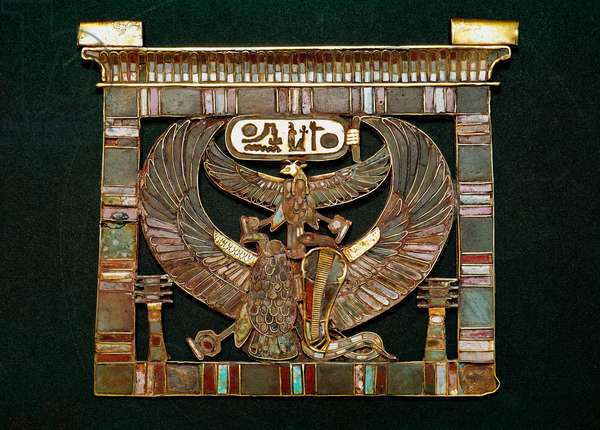 Egyptian antiquite: pectoral of Pharaoh Ramses II (1279-1213 BC) 19th Dynasty. In the center the goddess cobra Ouadjet and the vulture goddess Nekhbet, above a vulture with the head of belier. Made of electrum and colored glass. From Saqqara. Paris, Musee du Louvre - Egyptian Antiquities: Breastplate of Pharaoh Ramses II (1279-1213 BC).19th Dynasty. In the middle, the cobra goddess Wadjet (Ouadjet) and above, the vulture goddess Nekhbet with a ram's head. Made in electrum and colored glass. From Saqqara. Louvre Museum, Paris, France