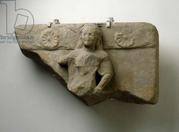 Part of a metope, the lower left part is missing ,