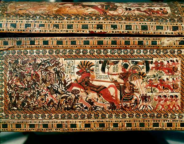 Egyptian antiquite: small wooden box with scenes depicting Pharaoh Tutankhamun chasing Nubians on his tank. 18th dynasty. From the tomb of Tutankhamun (All-Ankh-amun or Tutankhamun) (1345-1327 BC) Valley of the Kings. Thebes. Sun. 61 cm Cairo, Egyptian museum