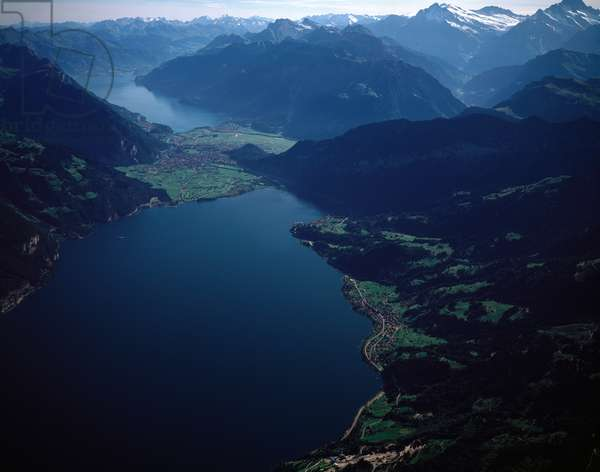 Aerial view of city of Interlaken between Thunersee lake (foreground) and Brienzesee (background), 1990 ca - Photography