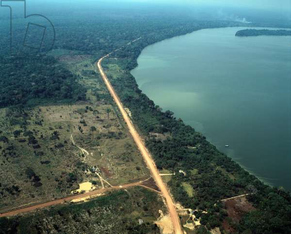 Air view on the Transamazonian road (BR-230) east of Humaita along the Madeira River, Brazil - Aerial view of Trans-Amazonian highway (BR 230 or Transamazonica) with Rio Madeira, east of Humaita, Brazil, 1983 - Photography
