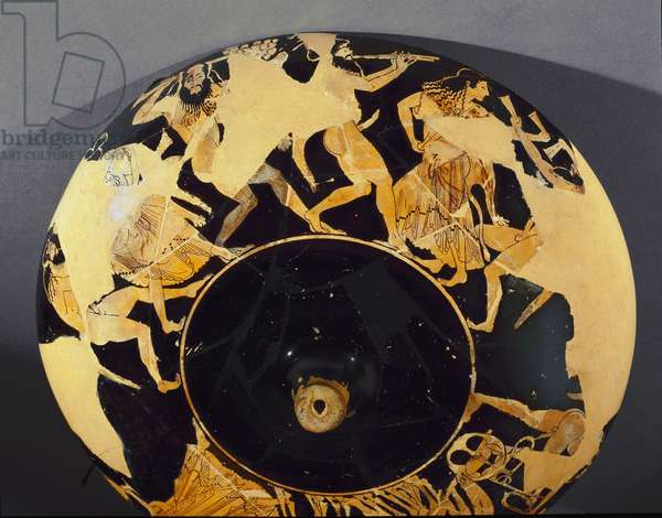 Greek art: type B kylix of terracotta with red figures painted by Euphronios (6th-5th century BC): representation of a frenzy dance of satyres and menades. Diameter 32 cm 510-500 BC. Paris Louvre Museum