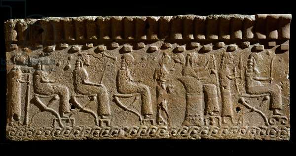 Etruscan civilization: terracotta frieze adorned with low reliefs of divinites and seated dignitaries. 580 BC Dim. 24x54 cm. From Murlo Palace. Murlo, Antiquarium Comunale
