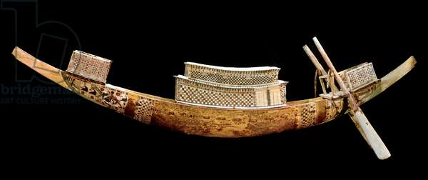 Egyptian antiquite: royal boat: it represents the journey of the deceased to the other world. Wood carving from the tomb of All-Ankh-Amon (Tutankhamun or Tutankhamun), valley of kings, Egypt. 1375-1358 BC. Egyptian Museum, Cairo, Egypt - Egyptian Antiquities: model of a royal boat for the symbolic transportation of the king through the sky of the Underworld. Wood carving from the Tomb of Tutankhamun (Tutankhamen or Tutankhamon), Valley of the Kings, Thebes, Egypt. 1375-1358 BC. Egyptian Museum, Cairo, Egypt