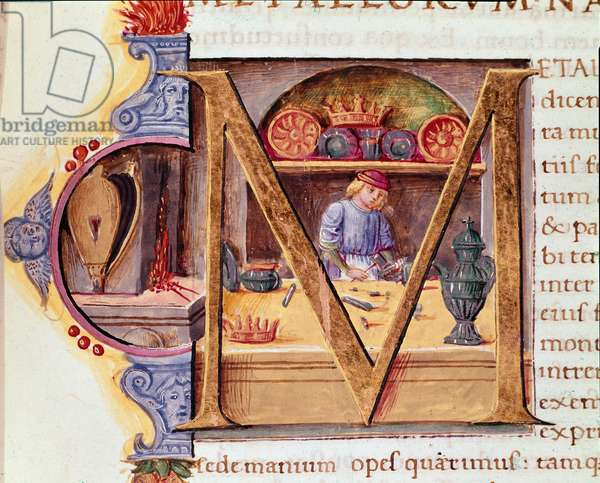 """A blacksmith at work in his workshop. Mansucrit """"Natural History"""""""" by the Roman writer and naturalist Pliny the Elder (23-79 AD) 15th century Venice Biblioteca Marciana"""