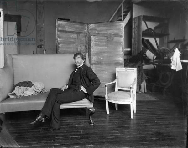 James Whistler (1834-1903) in his studio in front of the painting 'Blue and Silver - Screen with the Old Battersea Bridge' (b/w photo)