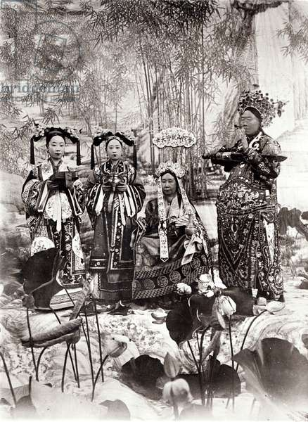 Portrait of Tz'U-Hsi (1835-1908) Empress Dowager of China accompanied by two maids of honour and a guard (b/w photo)