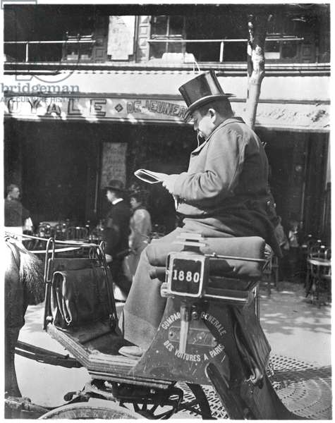 Parisian cabman reading his newspaper, c.1900 (b/w photo)