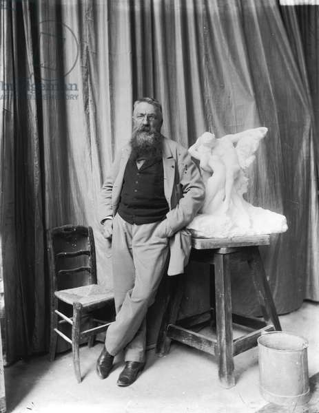 Auguste Rodin (1840-1917) with a plaster cast of 'Spring' (b/w photo)