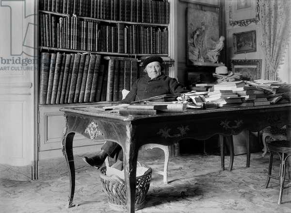 Victorien Sardou (1831-1908) at his work table (b/w photo)