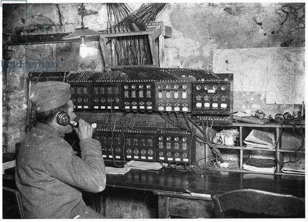Telephone in a cellar, Belgium, 1915 (b/w photo)