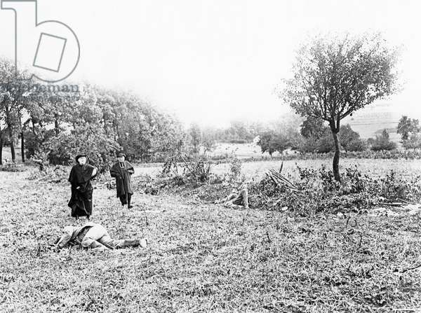 Priest blessing the dead of the Battle of the Marne, 1914 (b/w photo)