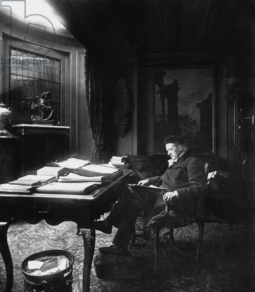 Victorien Sardou (1831-1908) at his desk (b/w photo)