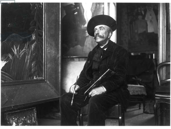 Henri (Le Douanier) Rousseau (1844-1910) in his studio at rue Perrel, Paris, 1907 (b/w photo)