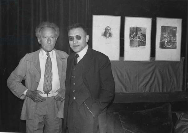Jean Cocteau in his Palais Royal apartment with his friend René Bailly, editor at Larousse, 1957 (b/w photo)