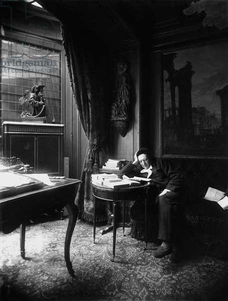 Victorien Sardou (1831-1908) reading the newspaper (b/w photo)