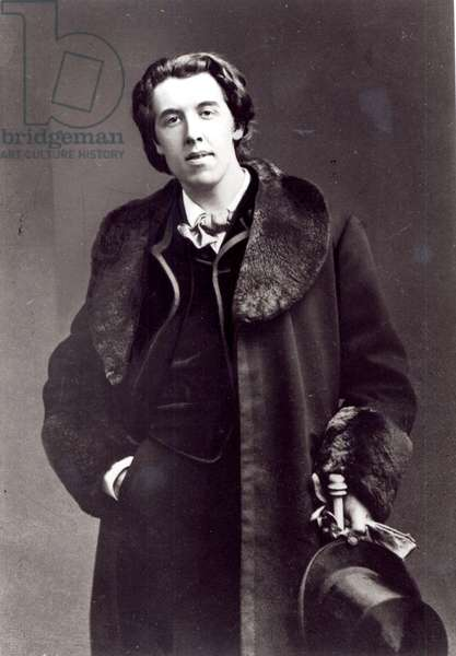 Oscar Wilde (1854-1900) wearing an overcoat with a fur collar bought for his trip to America (b/w photo)