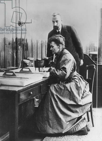 Pierre and Marie Curie in their laboratory in Paris, c.1900 (b/w photo)