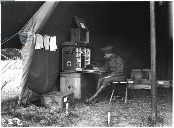 Doctor in an American hospital tent, c.1915 (b/w photo)