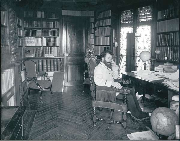 Camille Flammarion (1842-1925) in his study, 1893 (b/w photo)