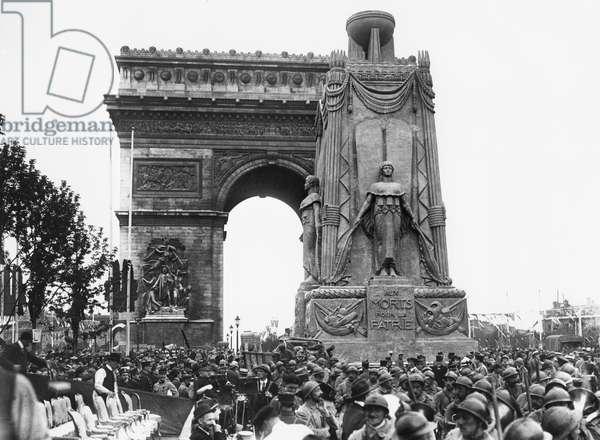 Celebrating 14th July at the Arc de Triomphe, Paris, 1919 (b/w photo)