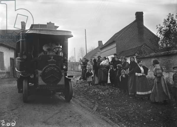 Bus arriving in a village, 1914 (b/w photo)
