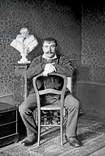 Portrait of a young man, posing in the Abbey of Septfontaine, in Andelot Blancheville, near Chaumont in Haute Marne. Photography around 1886 by Paul Emile Theodore Ducos (1849-1913).