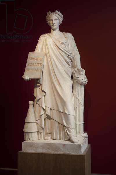 """The French Republic. Represented as a woman dressed in an antique drape and holding a plaque with the motto """"Liberte, Egalite, Fraternite"""", the hive at its feet represents fertility and order, the axe and beam are insignia of power, this allegory reproduces the usual shema of republican monuments that bloom in France after the revolution. of 1848, then after 1870 under the third republic. Artwork by Ferdinand Taluet (1820-1904), cast in plaster, 1848. Museum of Fine Arts in Angers."""