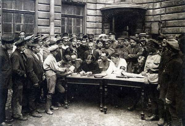 Young volunteers entering the recruitment office during the Russian Revolution in 1917.