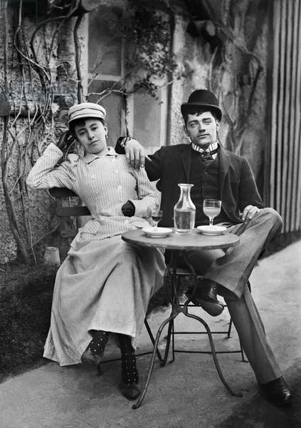 Portrait of a couple of the bourgeoisie taking the aperitif in the Abbey of Septfontaine. Photography around 1886 by Paul Emile Theodore Ducos (1849-1913).