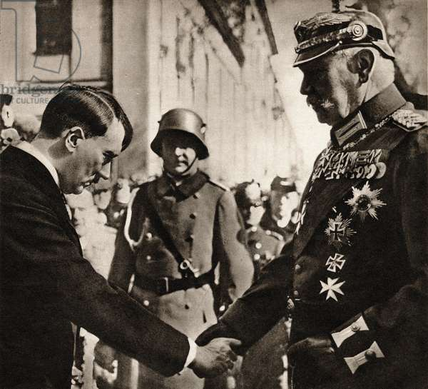 """Adolf Hitler (1889-1945), Chancellor of the Reich, and Paul von Hindenburg (1847-1934), President of the Reich shake hands, March 21, 1933, in Potsdam - Photography in """""""" die Woche"""""""" 2/08/1934 - Collection by Selva"""