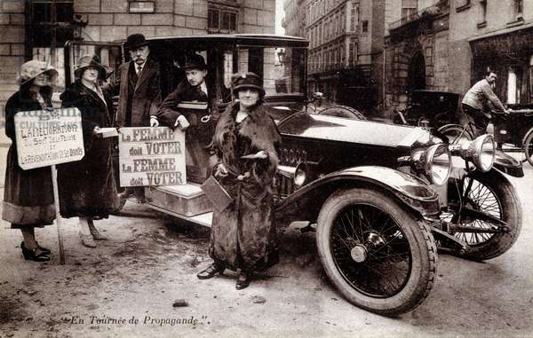 "Suffragettes and their signs: ""Women must vote"", circa 1920"