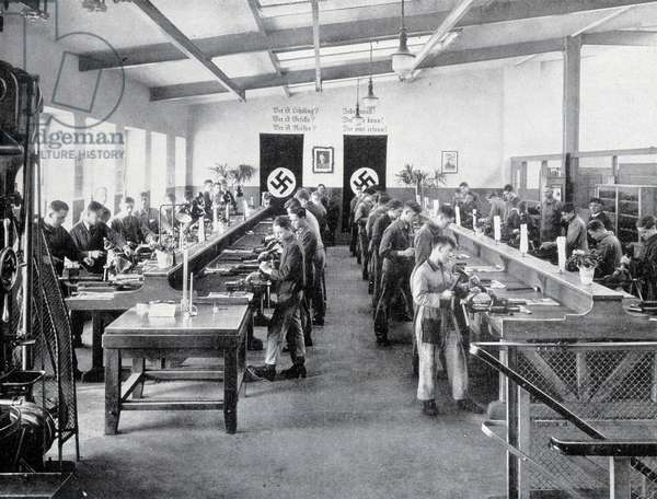 An apprentice workshop, decorated with swastika crosses, under the Third Reich