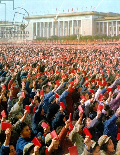Thousands of Chinese wield the little red book on Tian An Men Square during the Cultural Revolution, 1967