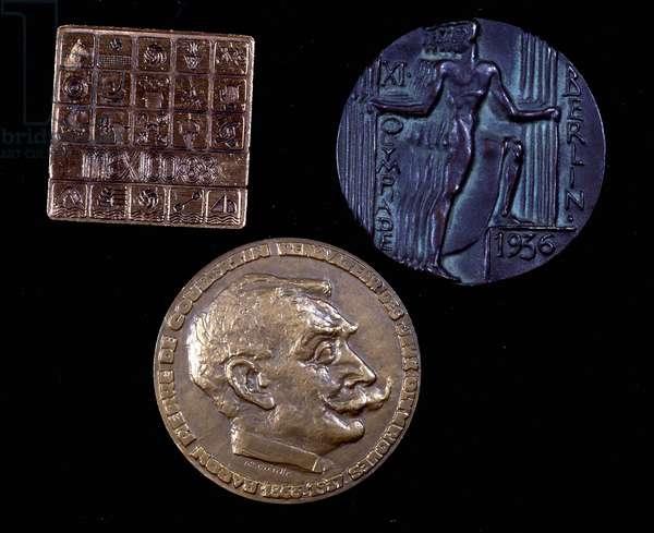3 commemorative medals: Mexico 1968, Berlin 1936, Baron Pierre de Coubertin, renovator of the Olympic Games 1863-1937.