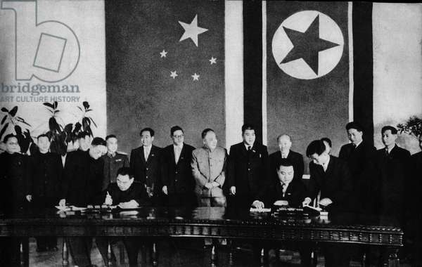 The signing of the alliance treaty between Chinese Prime Minister, Zhu Enlai and the leader of North Korea, Kim Il Sung, against the alliance of South Korea and the USA, 1950 (b/w photo)