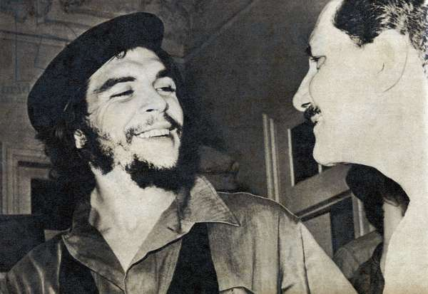 "Portrait of Ernesto Rafael Guevara de la Serna dit Che Guevara (1928-1967), during the Cuban Communist Revolution in 1959, with a journalist from ""Bohemia"""". Photograph, in """" Bohemia"""", January 11, 1959, Cuba."