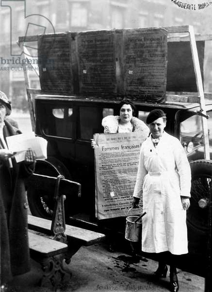 Suffragettes preparing to paste their posters, circa 1920