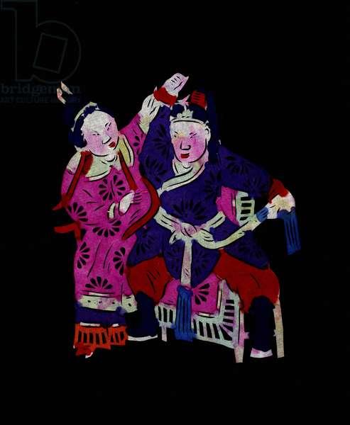 "A couple practicing martial art. Painted paper or ""Jian Zhi"", Chinese folk art, Leonard de Selva, China, 2006."