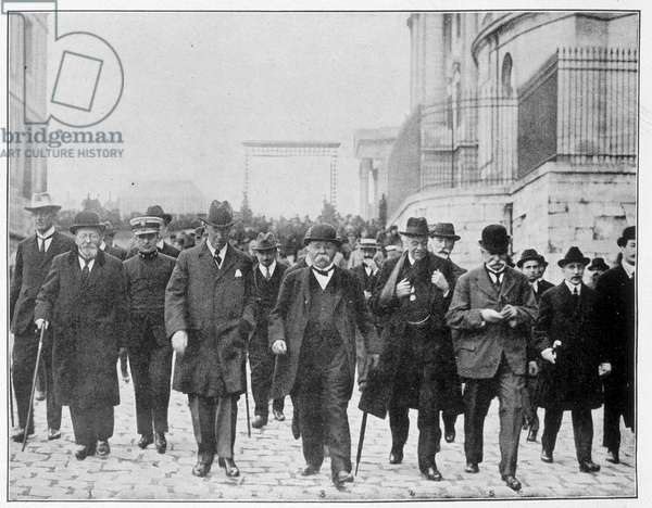 """Georges Benjamin Clemenceau (1841-1929), Woodrow Wilson (1856 - 1924), David Lloyd George (1863-1945) and Vittorio Orlando (1860-1952) known as The Four visit the Palaces of Versailles. They are united for the signing of the Treaty of Versailles. - in """"The Illustrated World"""""""" 28/6/1919."""