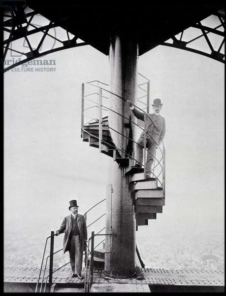 Gustave Eiffel and his son-in-law Adolphe Salles on the staircase of the Eiffel Tower, Paris, 1889