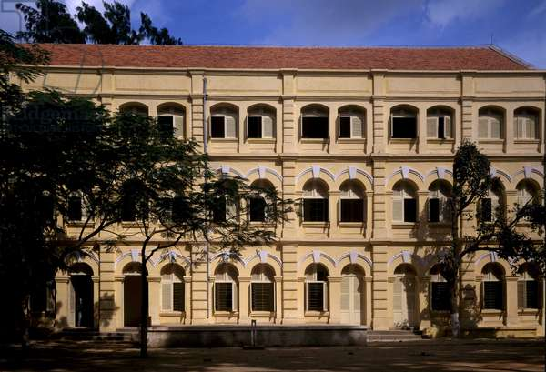 Colonial architecture in Vietnam: Detail of the Puginier School, Christian school founded by Monsignor Puginier, built in 1898, military style architecture.