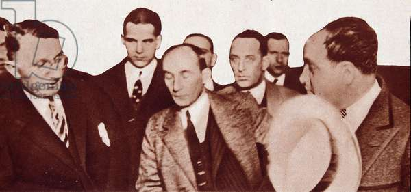 "Al Capone at the time of his arrest in May 1929, among the police - in """" Vu"""" Photography."