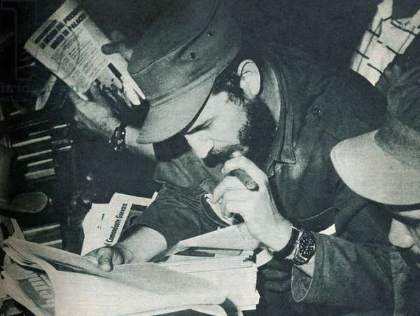 "Portrait of Fidel Castro (born in 1926), during the Cuban Communist Revolution in 1959, reading the newspaper """" Bohemia"""". Photography in """" Bohemia"""", January 18-25, 1959, Cuba."
